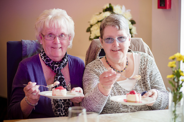 Photo of elderly ladies enjoying cake