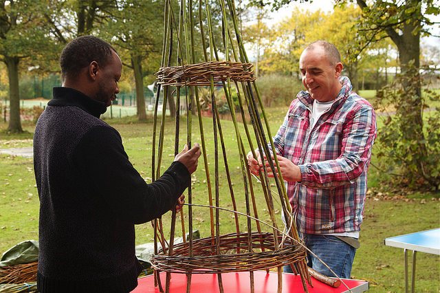 Photo of adults making a game with sticks