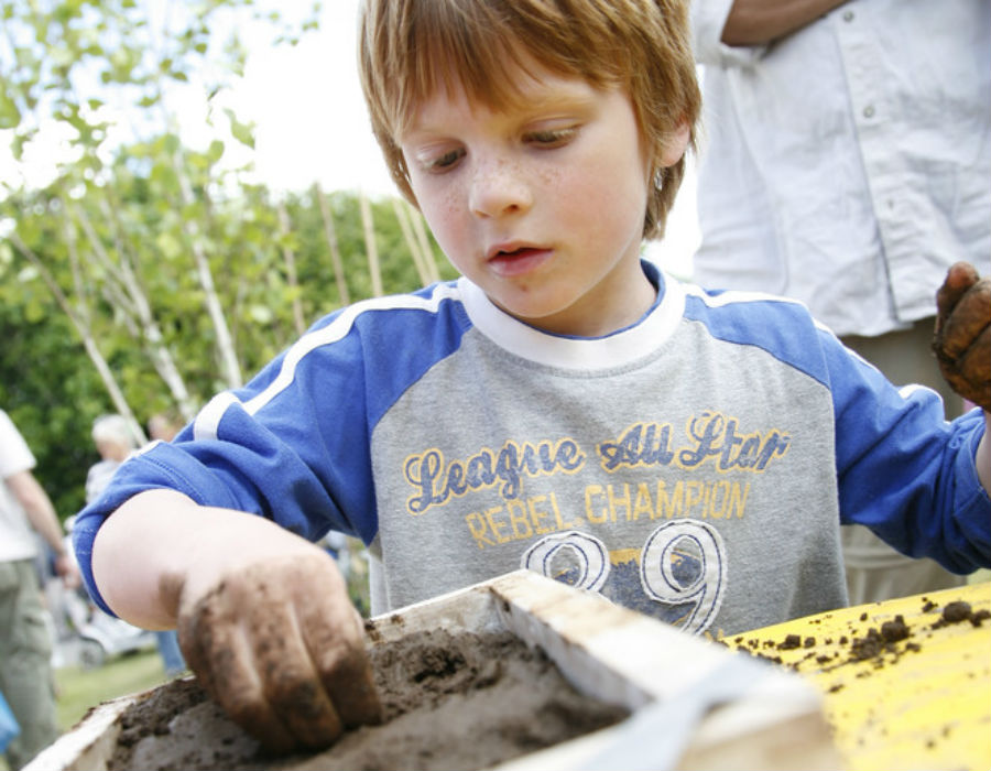 Boy playing with soil