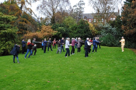 People practicing qi gong in the park.