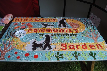 A mosaic saying community garden.