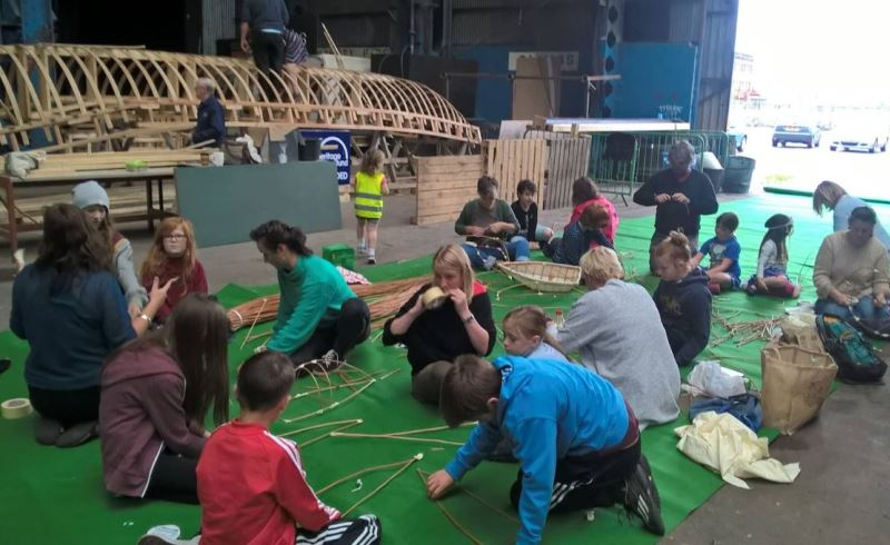 Children participating in a workshop to build miniature currach boats.
