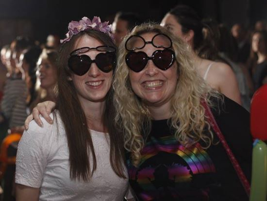 Two women smiling at a disco.