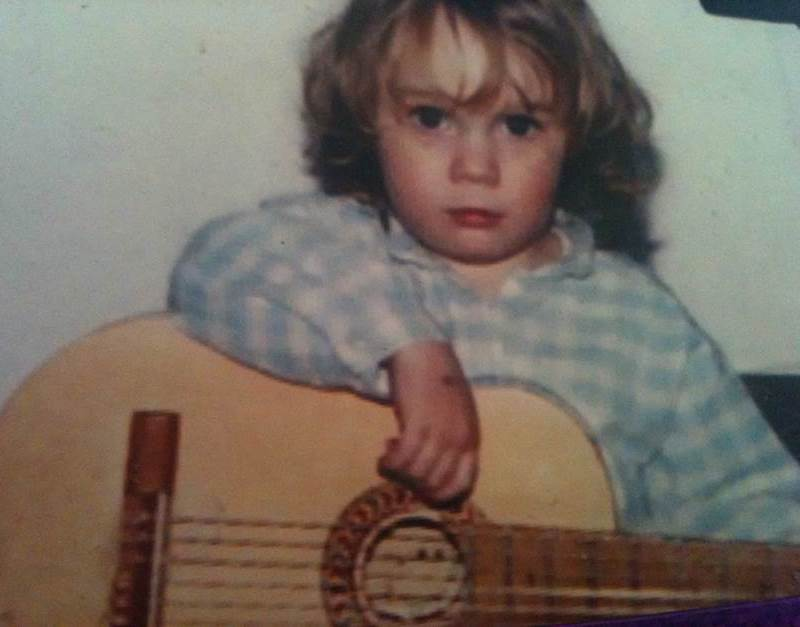 A child playing a guitar.