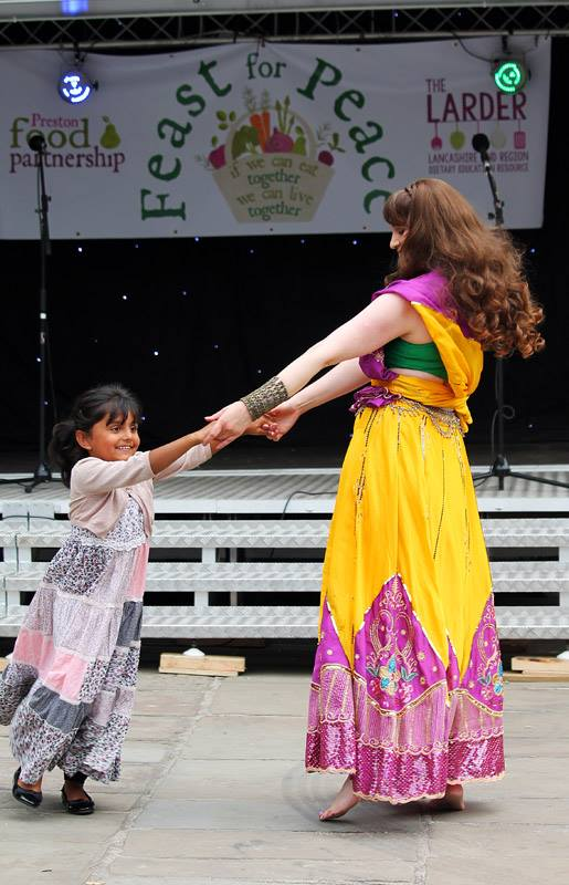A young girl and woman dancing.