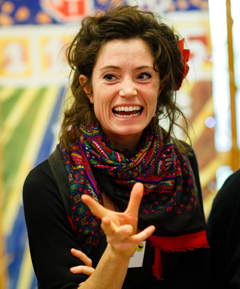A woman smiling excitedly.