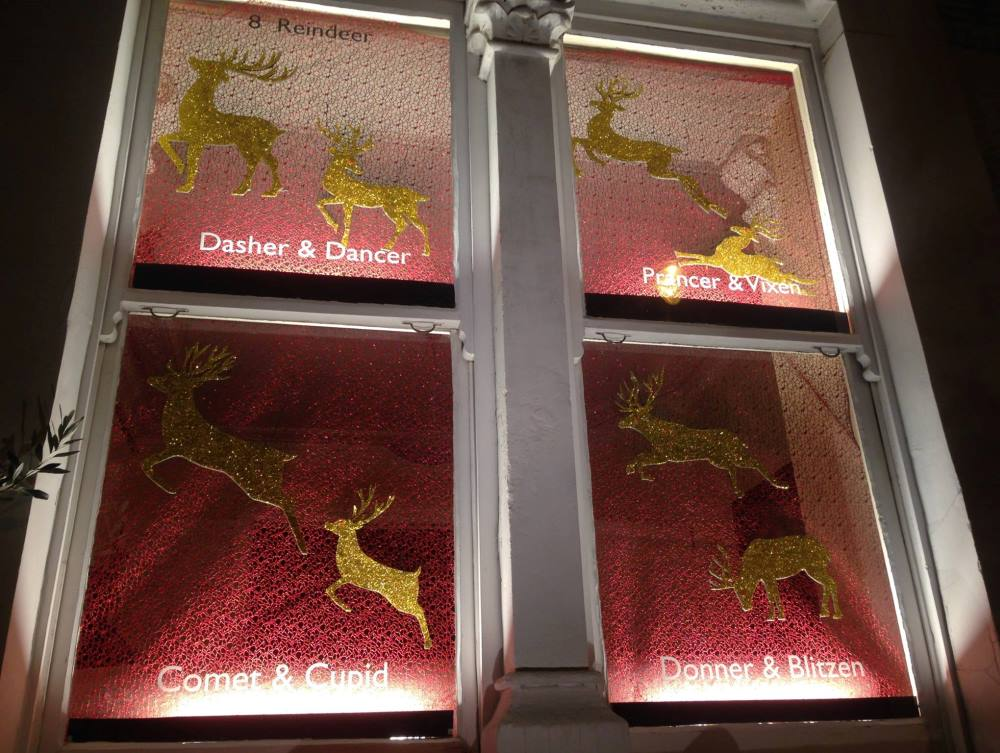 A window display of Santa's reindeers.