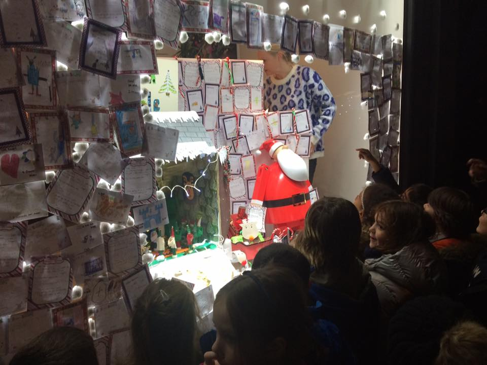A window display of notes to Santa.