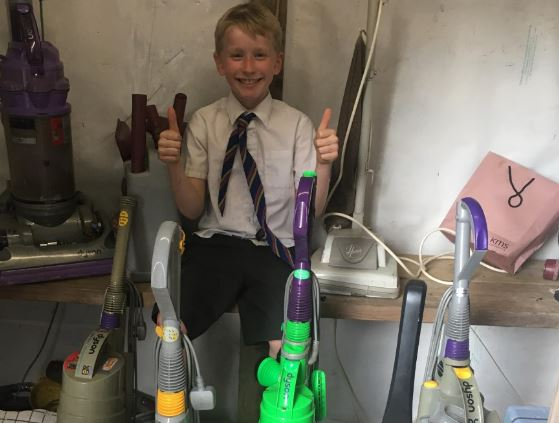 Photo of Michael and multiple hoovers