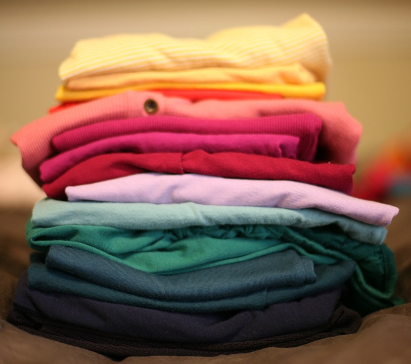 Folded clothes in a pile.