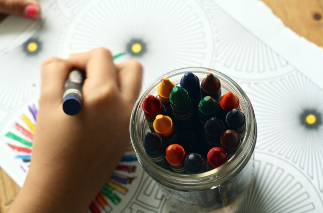Photo of colouring book and pens