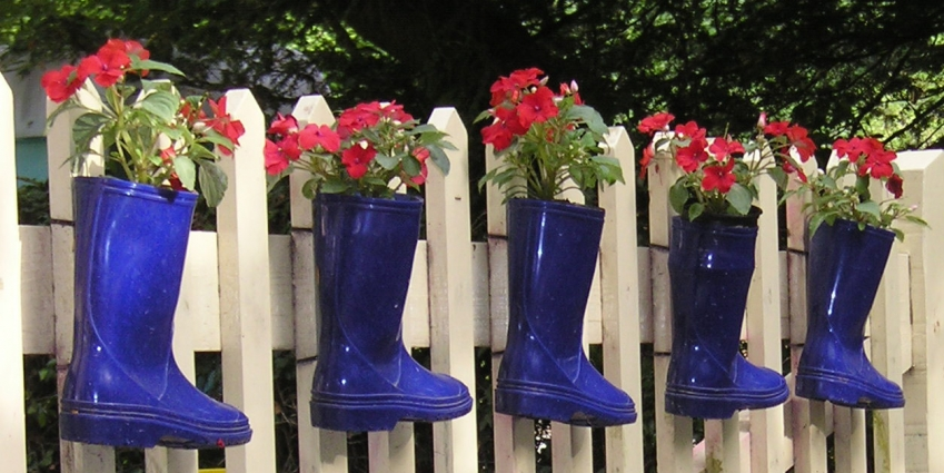 flowers planted in wellies