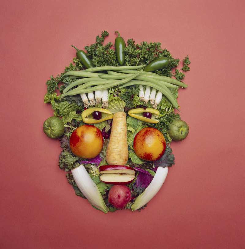 Face made out of vegetables and fruit.