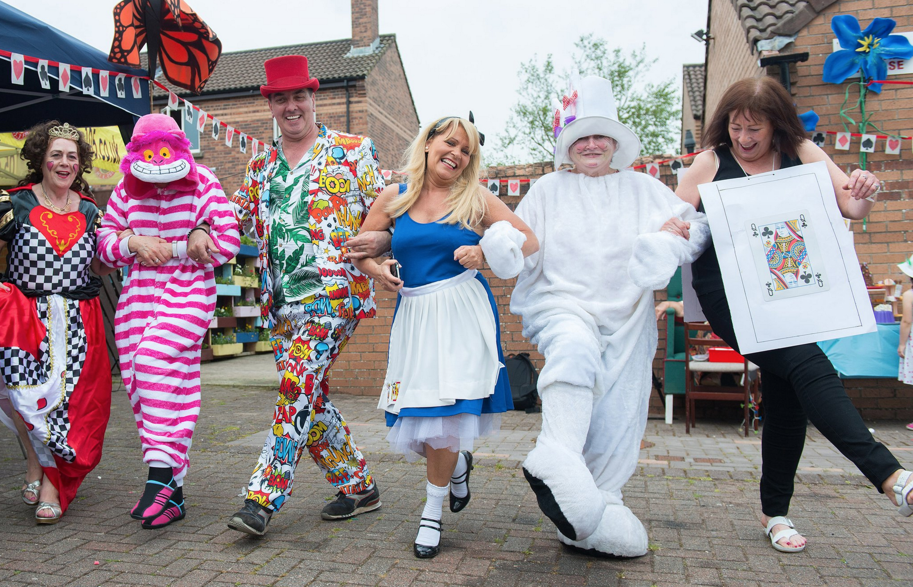 Photo of Habinteg staff dressed up in the characters of Alice In Wonderland.