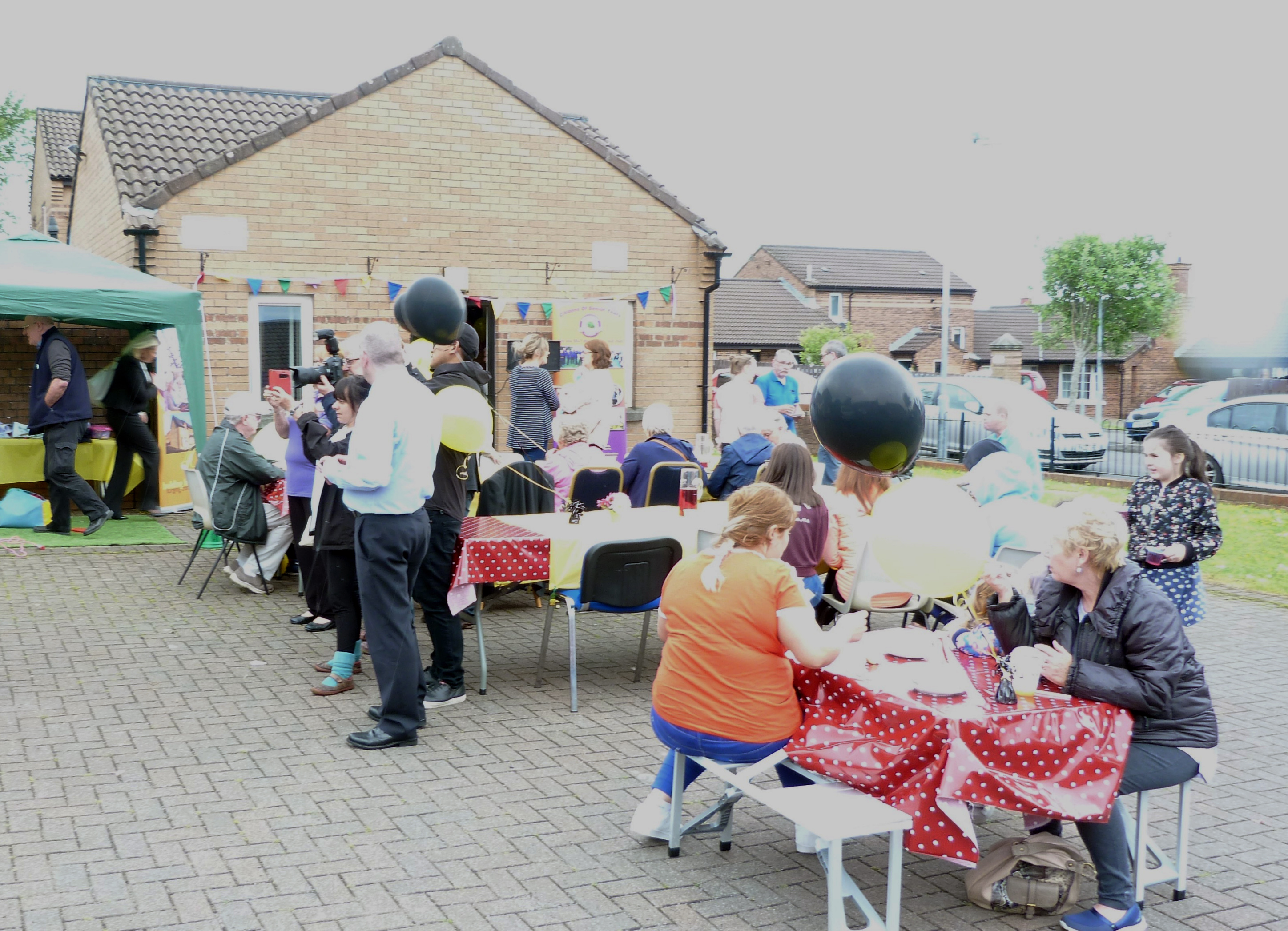 Photo of the people of Farland Way, enjoying Habinteg Housing Association's 40th birthday street party lunch.