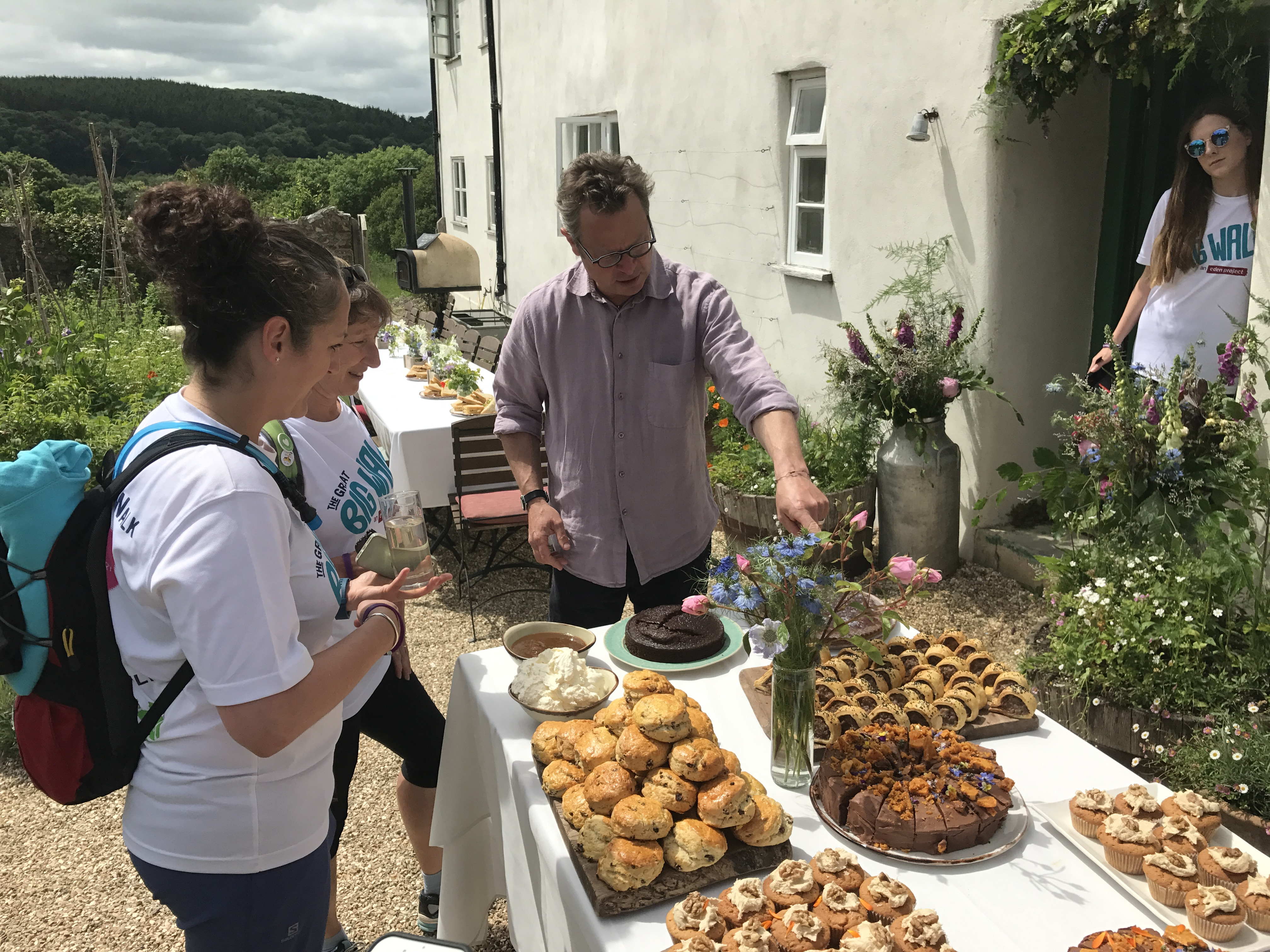 Hugh showing Jude and Jane the feast at River Cottage.