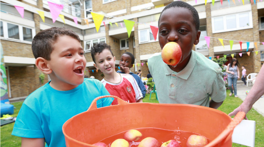 Children apple bobbing