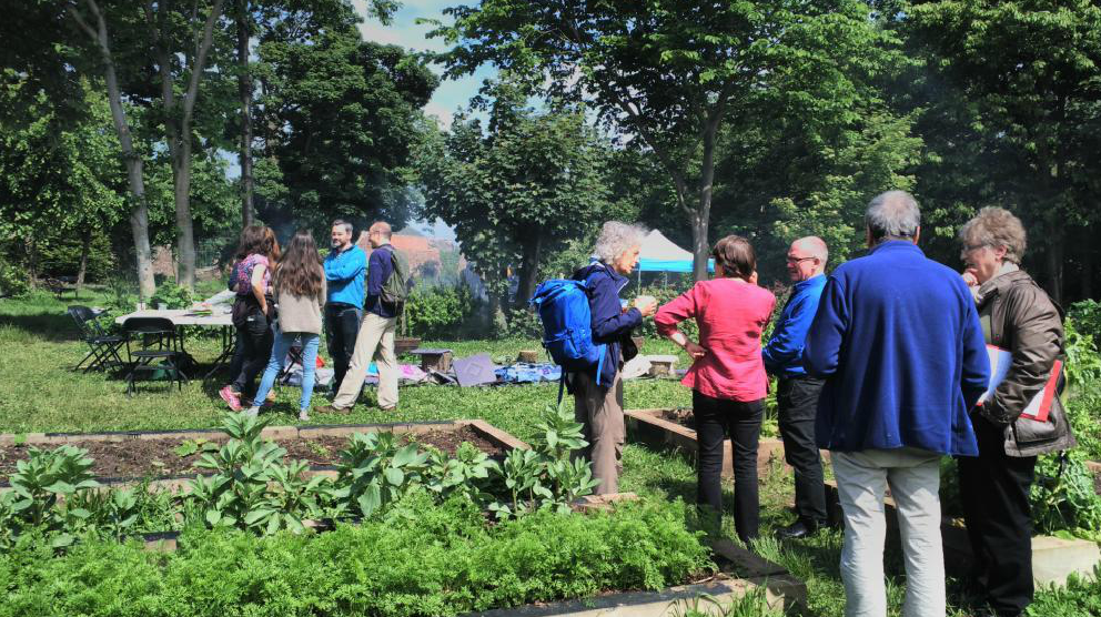 People gathering around community vegetable plots
