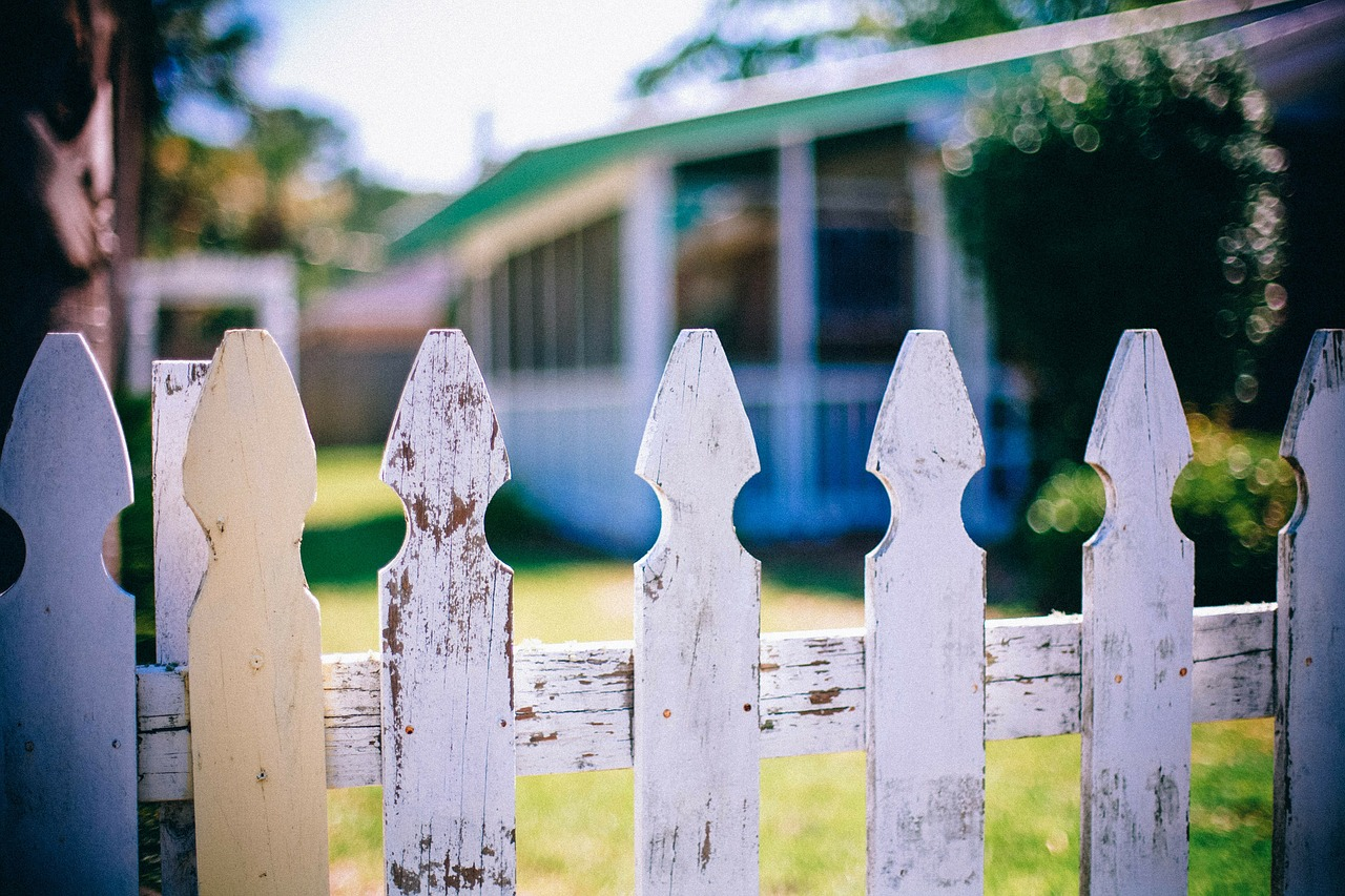 Photo of a house behind a fence
