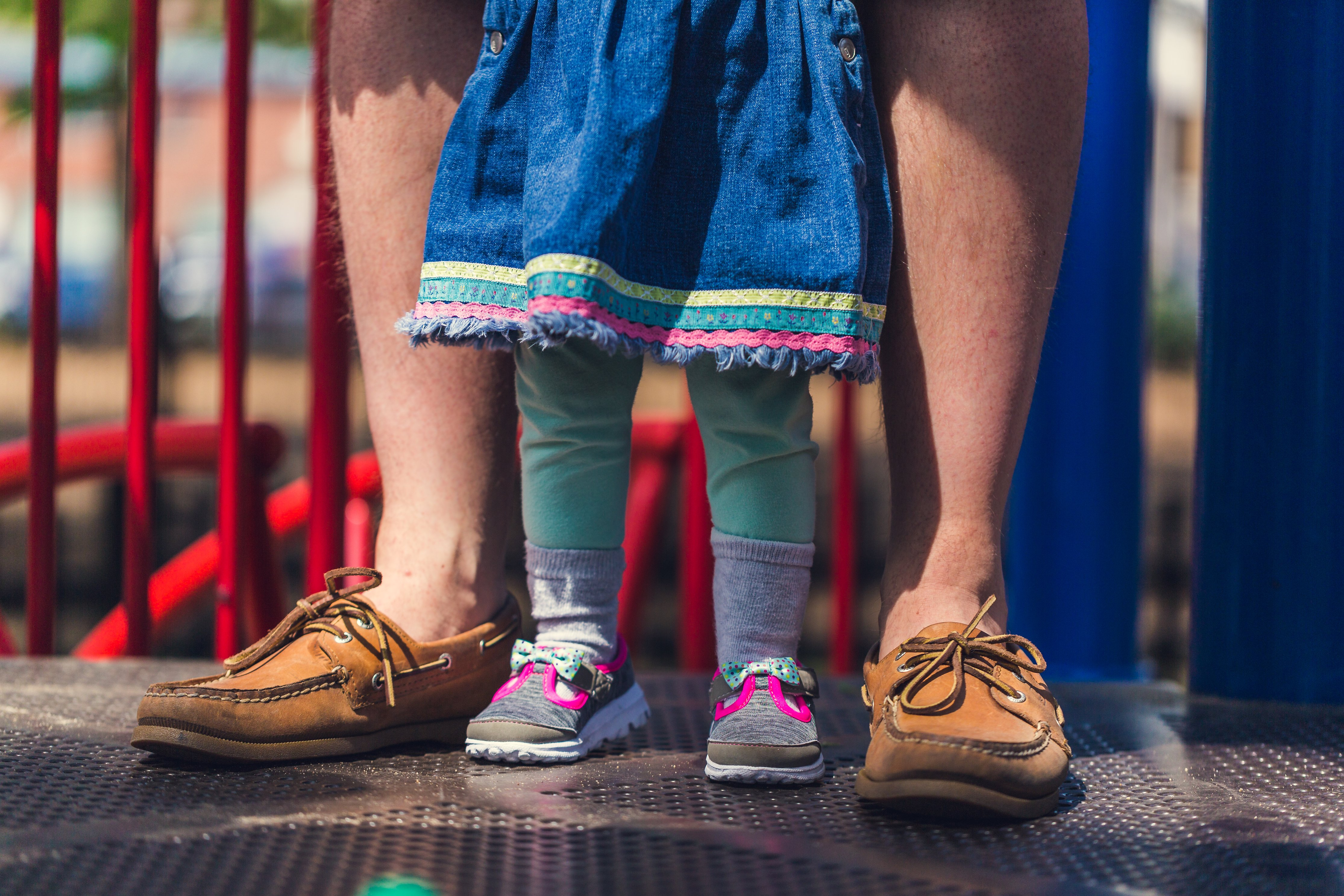 Photo of a child and parent's feet together