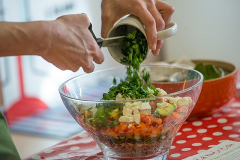 A healthy salad being made.