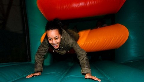 Photo of young adult on an inflatable playarea