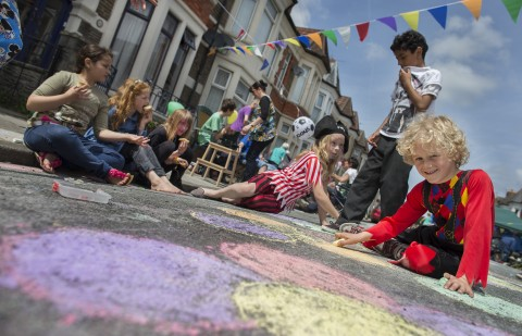 Photo of children experimenting with chalk street art