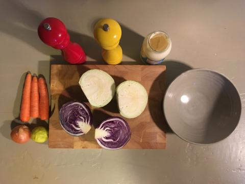 Ingredients for coleslaw on a chopping board.
