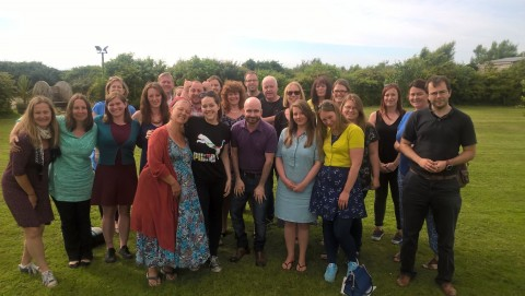 The Eden Project Communities team gathered on a field.