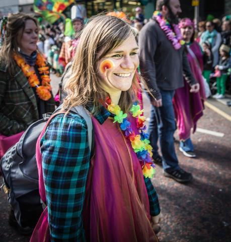 Niamh in a parade with a rainbow on her face.