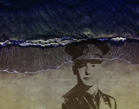 Pages of the Sea: a portrait of a World War One soldier, emerging from the sand on a beach.