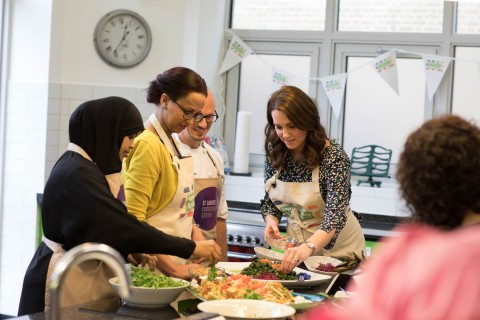 The Duchess of Cambridge helping prepare food at St Luke's