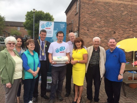 Photo of Team Norther Ireland's Noel, standing with staff from Habinteg Housing Association and the Deputy Mayor of Derry City & Strabane, with their 40th birthday cake.