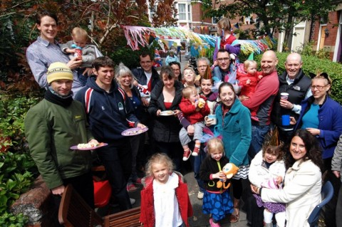 Big lunch street party with families.