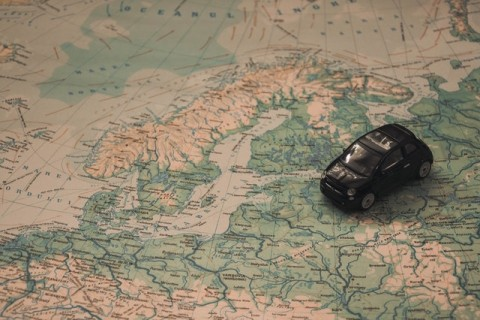 Photo of a car travelling across a map