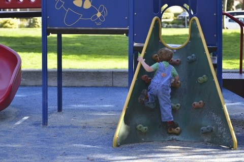 Photo of a child in a play area