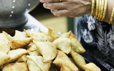 A woman making samosas