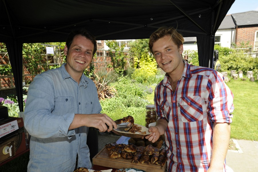 Two young men at a barbeque.