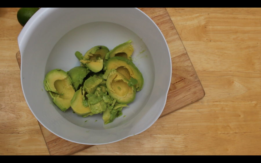 Cut your avocado into medium chunks and mash in a large bowl with a fork until it's a smooth consistency with a few chunks left.