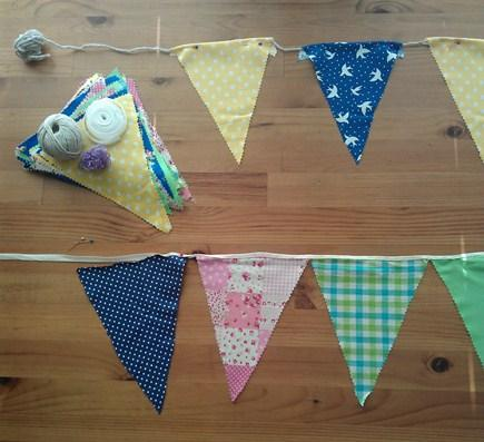 Bunting flags spaced out along bias tape ready for sticking into place.
