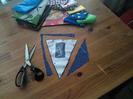 A template to make bunting attached to scrap material.
