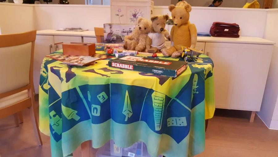 A printed table cloth with toys on top.