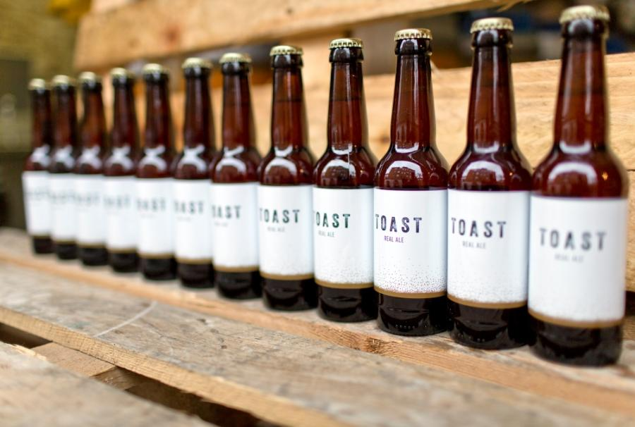 A line up of beer bottles made by Toast brewery.