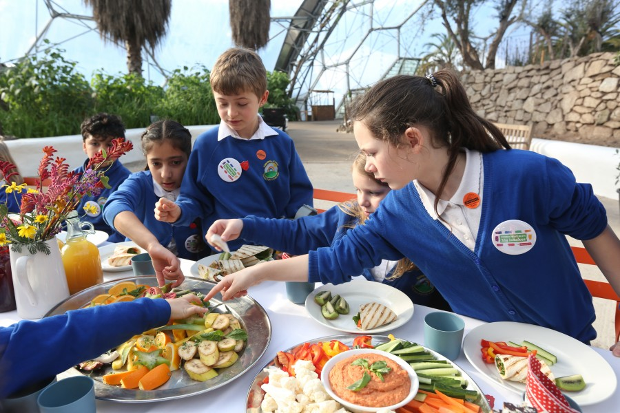 children tasting fruits from around the world