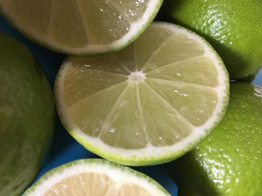 Close up photo of limes chopped in half.