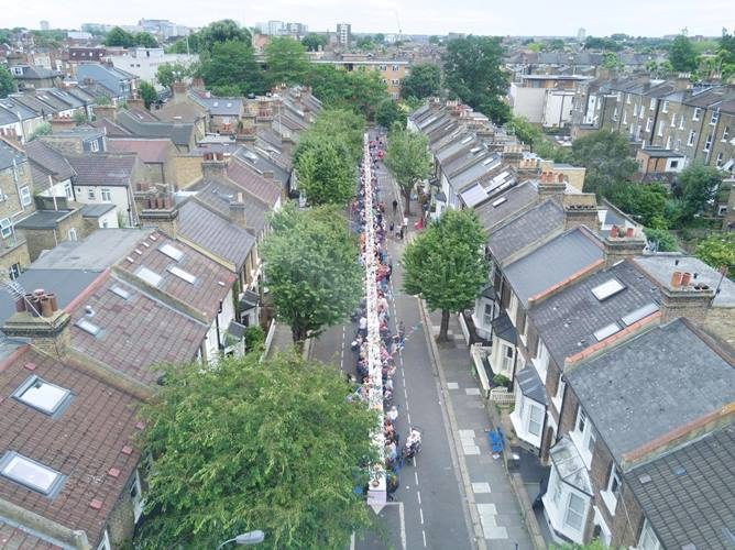 Long table stretched through Shepherd's Bush for Big Lunch.