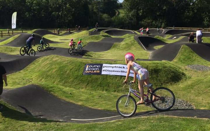 Girl riding a bike on a track